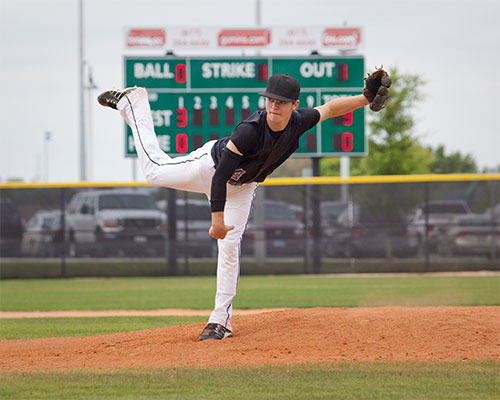 Young boy pitching in a baseball game